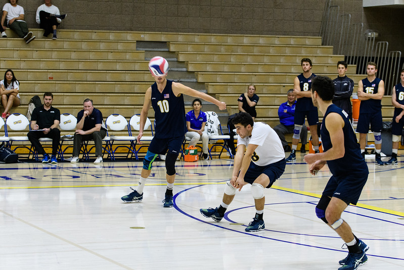 Parker Boehle receives a top-spin jump serve.