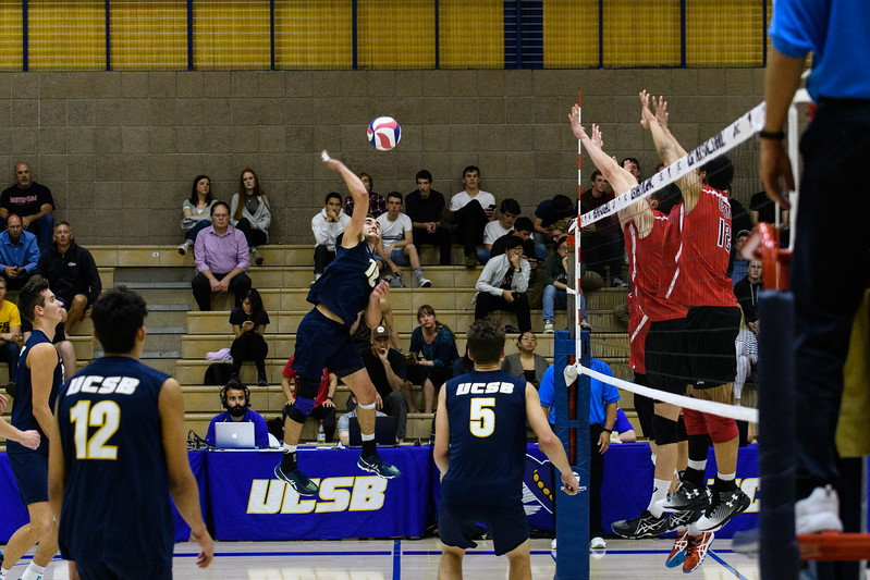 Hayden Boehle swings  through the CSUN block.