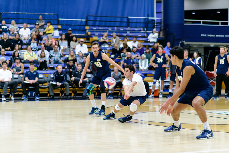 Parker Boehle shifts sideways to receive a fast jump serve.