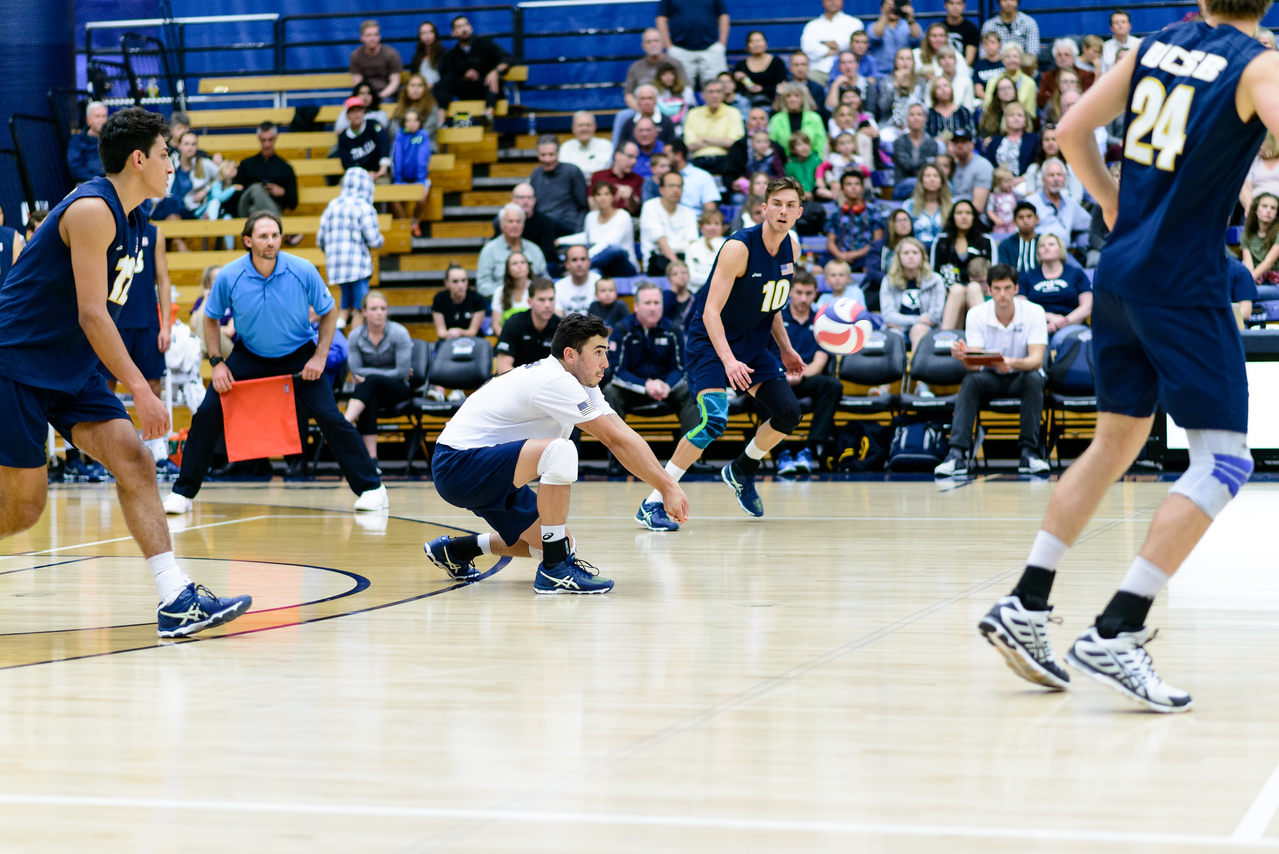 Parker Boehle drops down to take a fast jump serve.