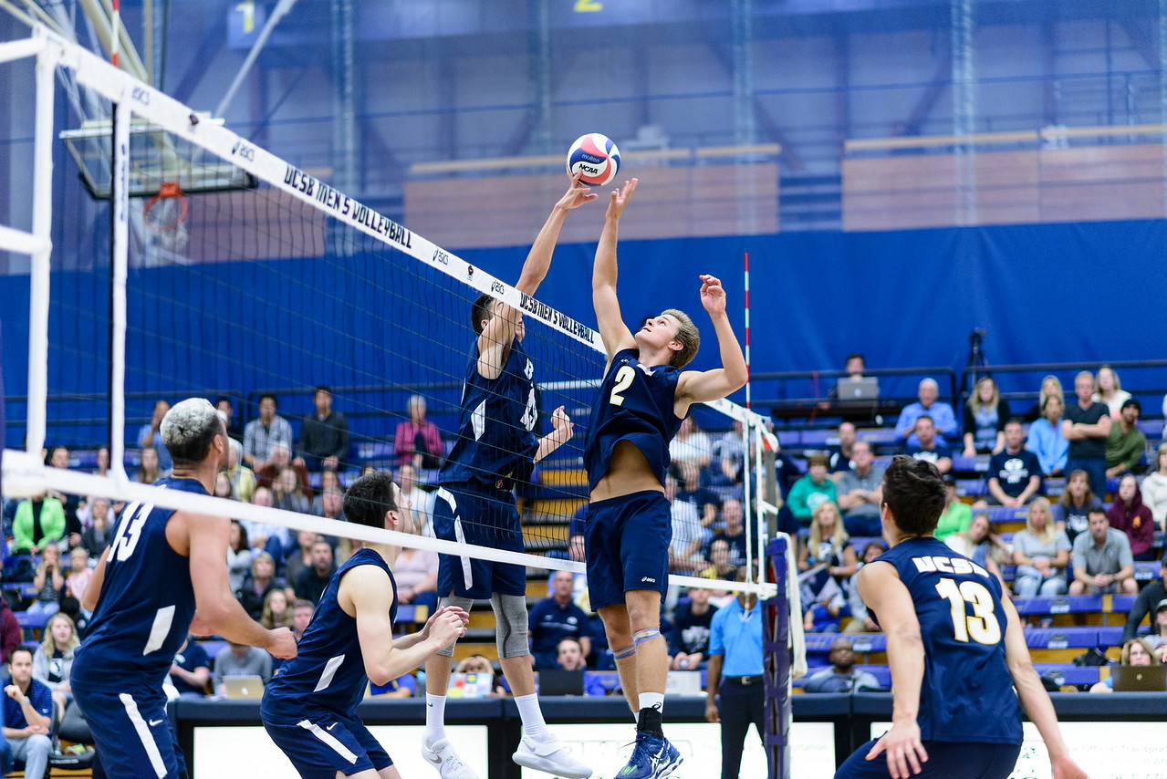 Casey McGarry goes up to joust with the BYU hitter.