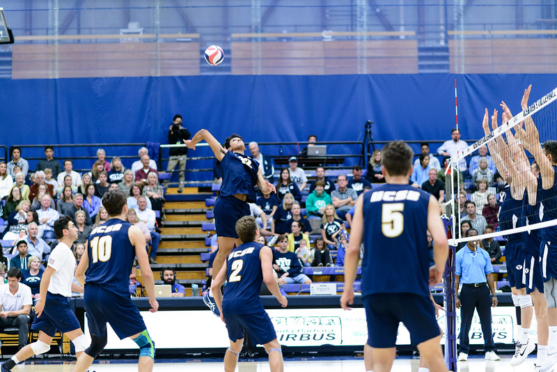 Corey Chavers swings off the net over the BYU block