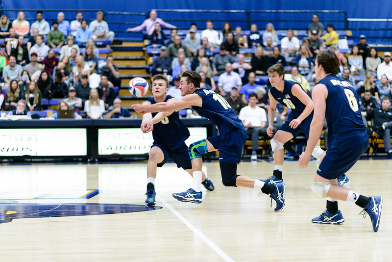 Jacob Delson and Keenan Sanders rush for a ball tipped off the block.