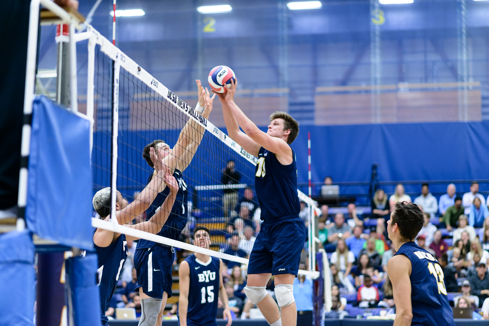 Randy DeWeese dumps the ball through the BYU middle's block.