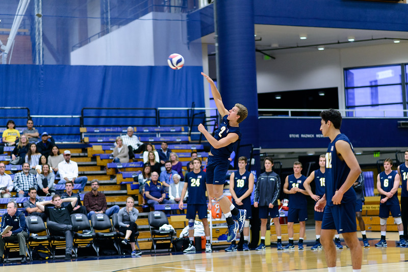 Casey McGarry serves a controlled jump serve down the line.