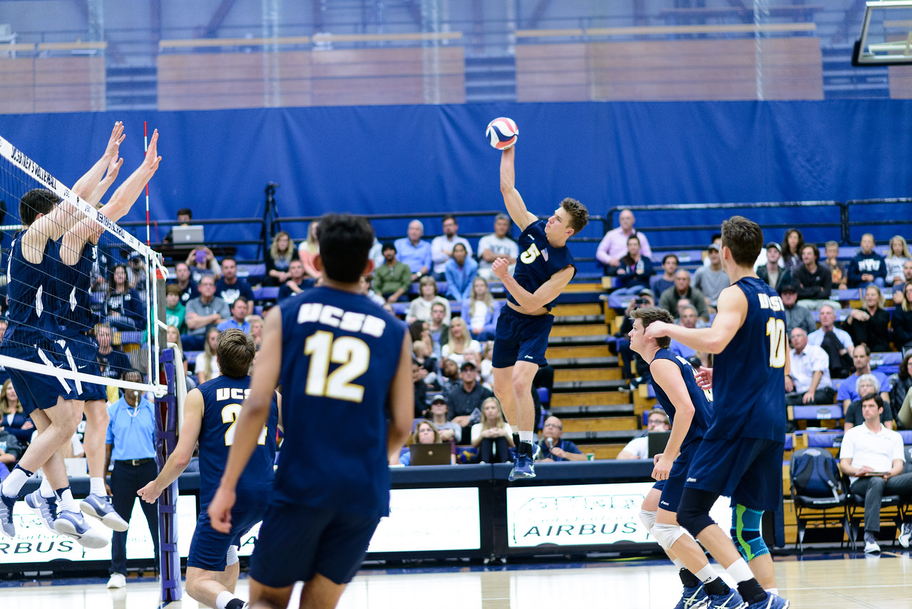 Keenan Sanders spikes off the net in a long, hard-won rally against BYU.