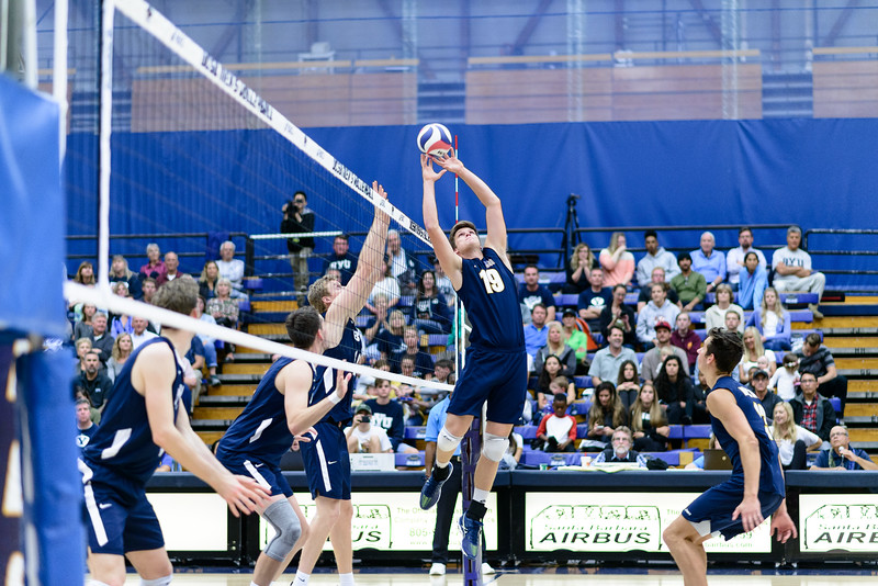 Randy DeWeese cleanly sets a tough ball pushed tight to the net.