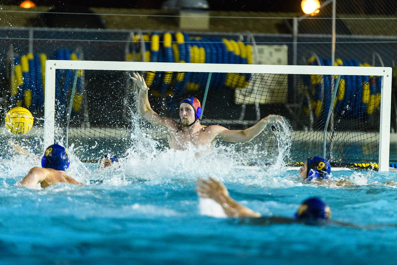 Liam Lenihan III jumps out of the water, stoic and ready to block a shot