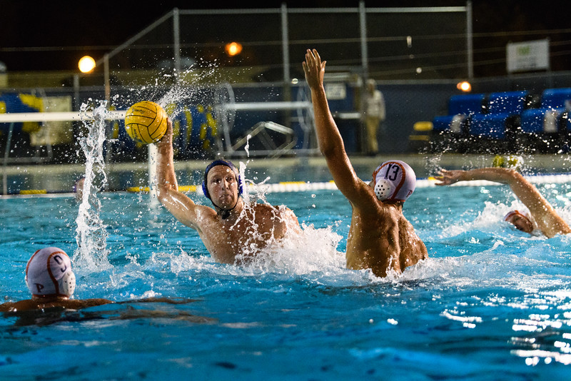 Reed Cotterill takes a shot under outstretched arm of the Pepperdine defender.