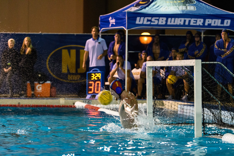 Senior Goalie Liam Lenihan III jumps out of the water to block a shot in the first quarter.