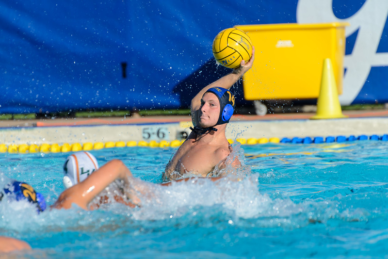 Mitch Young pump fakes before taking a shot on goal against La Verne.