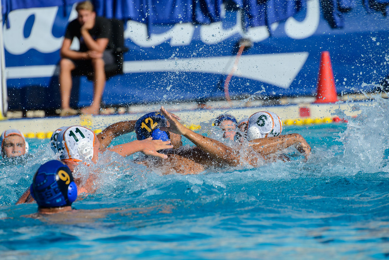 Jack Winther lunges upward to pressure the La Verne attacker.