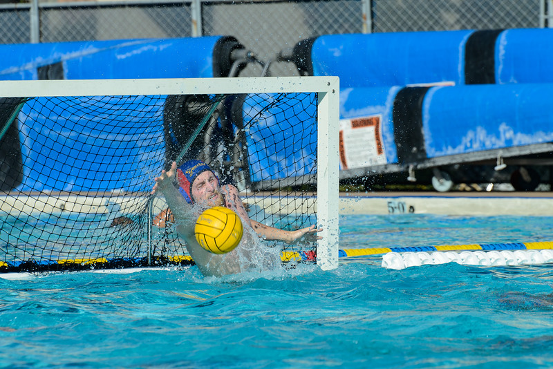 Goalkeeper Liam Lenihan III reaches out and blocks the La Verne shot.