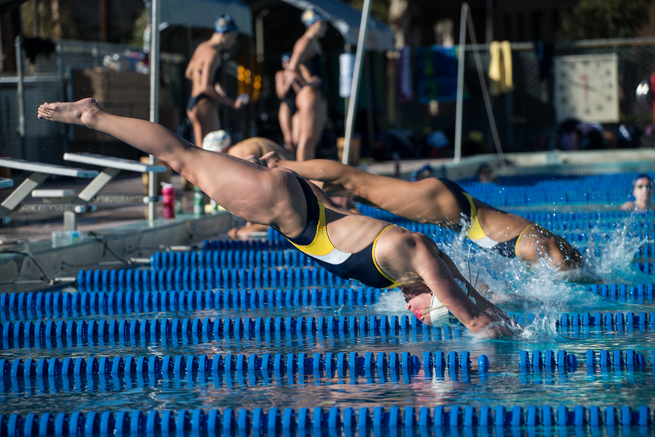 UCSB Swimmers dive in to the 200 fly event, lanes 4, 6