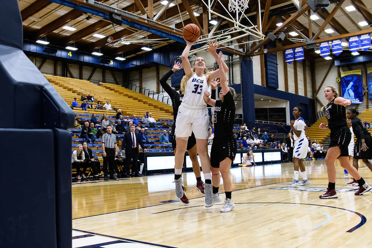 Natalia Burening jumps up through the Broncos defense to take a shot, forcing a foul called on the Broncos.