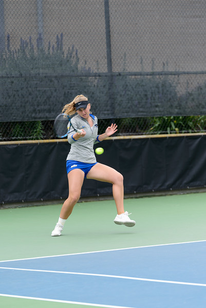 Paulina Dubavets swings a deep forehand shot for the point against Harvard's Erica Oosterhout