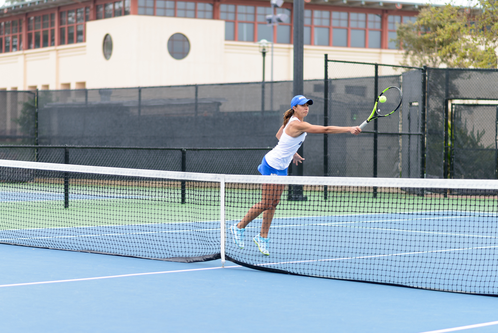 Amanda Atanasson volleys a ball at net.