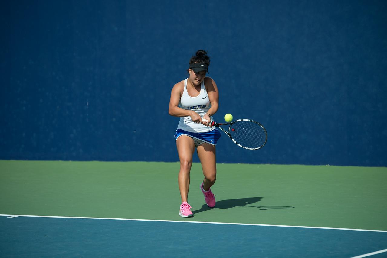 Natalie Da Silveira returns a tight backhand in the #2 singles match.