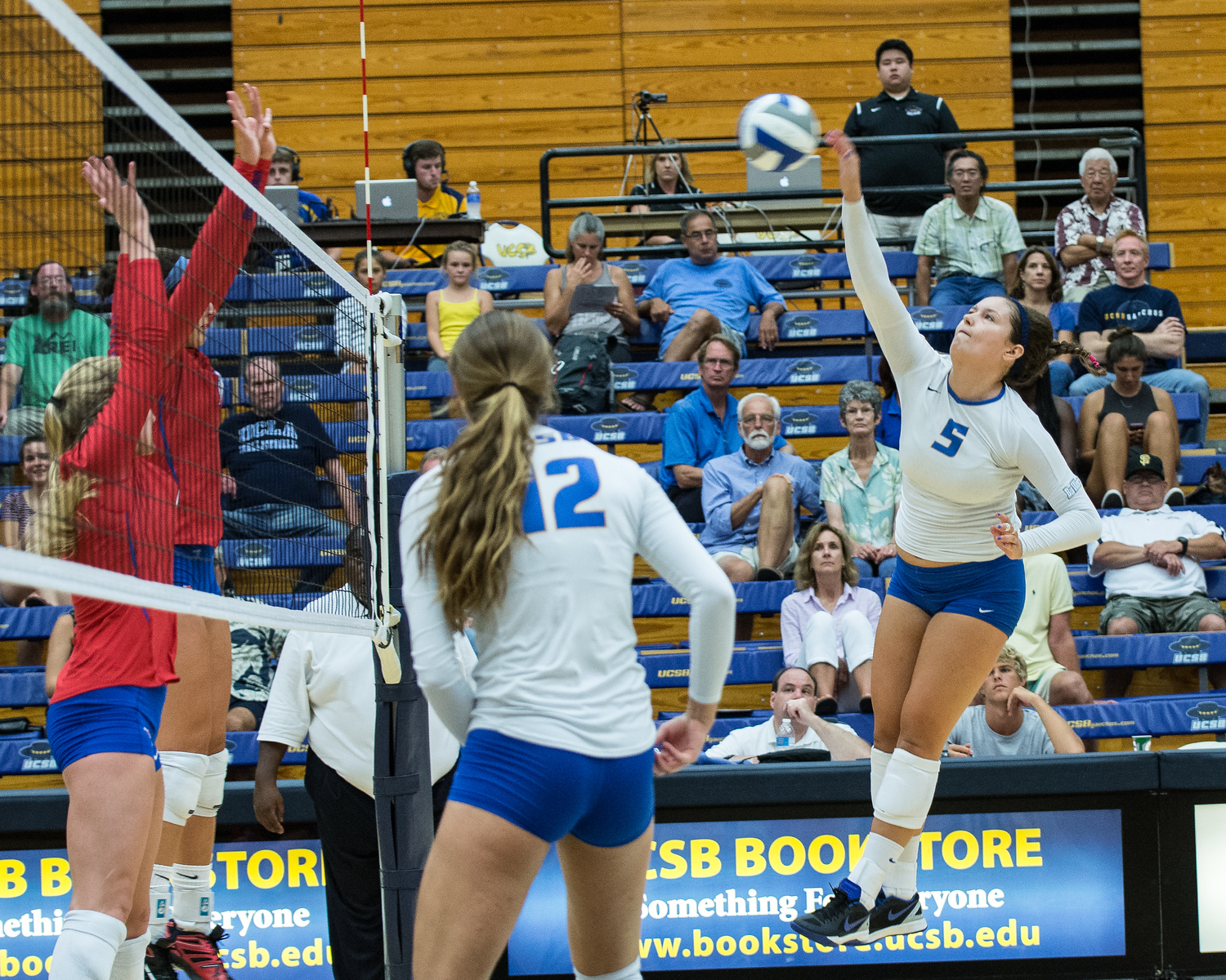 Britton Taylor swings a kill over the SMU middle blocker, taking advantage of the middle's late jump.