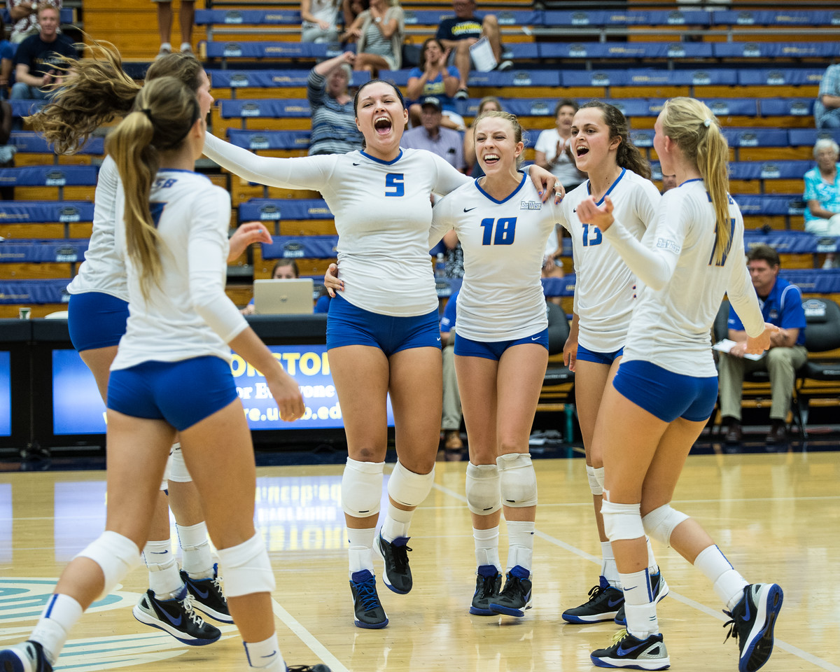 Britton Taylor rejoices with her teammates after a deep kill down the line.