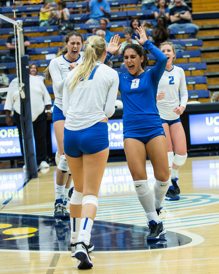 Emilia Petrachi celebrates with Devin Joos after a series of scrappy plays led to a solid kill.