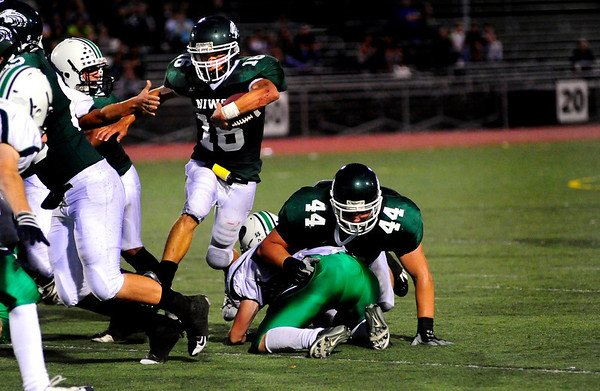 S0911FTBALL5.jpg Niwot High School QB Kelton Manzanares (16) runs the ball while FB/LB Tyler Strong (44) blocks Standley Lake OL/DL Adam Parker at the Niwot vs. Standley Lake football game at Longmont High School on Thursday night, Sept. 10, 2009.
