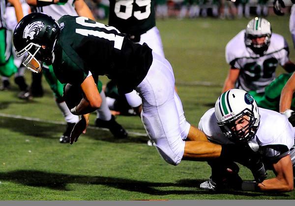 S0911FTBALL1.jpg Niwot High School quarterback Kelton Manzanares gets pulled down by Standley Lake High School RB/DB Jay Polachek at the Niwot vs. Standley Lake Football game at Longmont High School on Thursday night, Sept. 10, 2009.
