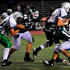 S0911FTBALL3.jpg Niwot High School quarterback Kelton Manzanares (16) and Tyler Strong (44) try to stop Standley Lake High School kicker Camden Castor at the Niwot vs. Standley Lake Football game at Longmont High School on Thursday night, Sept, 10, 2009.