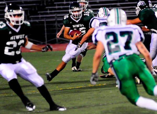 S0911FTBALL2.jpg Niwot High School quarterback Kelton Manzanares runs the ball at the Niwot vs. Standley Lake Football game at Longmont High School on Thursday night, Sept. 10, 2009.