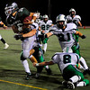 S0911FTBALL4.jpg Niwot High School QB Kelton Manzanares (16) is tackled by Standley Lake High School RB/DB Jay Polachek (8), FB/LB Conner Burgwald (31) and OL/DL Patrick Schall (53) at the Niwot vs. Standley Lake Football game at Longmont High School on Thursday night, Sept. 10, 2009.