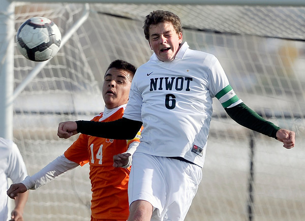Niwot High School's Grant Webster heads the ball over Diego Barrera during a game against Denver West High School on Thursday, Oct. 25, at Frederick High School.<br /> Jeremy Papasso/ Camera