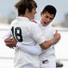 Niwot High School's Koen Litt, left, is hugged by David Almanza after scoring a goal during a game against Denver West High School on Thursday, Oct. 25, at Frederick High School.<br /> Jeremy Papasso/ Camera
