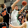 "Niwot High School's Henry Sebesta takes a shot over Greeley Central's Sheldon Darnell during a basketball game on Friday, Jan. 20, at Niwot High School. Niwot lost the game 49-45. For more photos of the game go to  <a href=""http://www.dailycamera.com"">http://www.dailycamera.com</a><br /> Jeremy Papasso/ Camera"