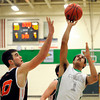 "Niwot High School's Forrest Lee takes a shot over Greeley Central's Shane O'Connell during a basketball game on Friday, Jan. 20, at Niwot High School. Niwot lost the game 49-45. For more photos of the game go to  <a href=""http://www.dailycamera.com"">http://www.dailycamera.com</a><br /> Jeremy Papasso/ Camera"