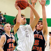 "Niwot High School's Jordan Keeler takes a shot over Greeley Central's Zach Elrick, No. 5,  during a basketball game on Friday, Jan. 20, at Niwot High School. Niwot lost the game 49-45. For more photos of the game go to  <a href=""http://www.dailycamera.com"">http://www.dailycamera.com</a><br /> Jeremy Papasso/ Camera"