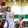"Niwot High School's Jordan Keeler goes for a lay-up over Greeley Central's Shane O'Connell, right, and Sheldon Darnell, left, during a basketball game on Friday, Jan. 20, at Niwot High School. Niwot lost the game 49-45. For more photos of the game go to  <a href=""http://www.dailycamera.com"">http://www.dailycamera.com</a><br /> Jeremy Papasso/ Camera"
