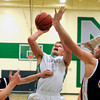 "Niwot High School's Nate Merriman takes a shot over Greeley Central's Shane O'Connell, right, during a basketball game on Friday, Jan. 20, at Niwot High School. Niwot lost the game 49-45. For more photos of the game go to  <a href=""http://www.dailycamera.com"">http://www.dailycamera.com</a><br /> Jeremy Papasso/ Camera"