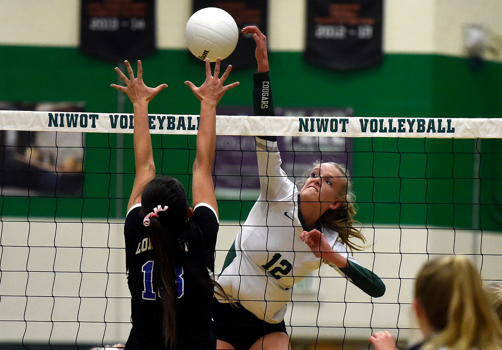 . NIWOT, CO - OCTOBER 18, 2018: Niwot High School\'s Emma Falk goes for a kill over Zoe Lowe during a volleyball game against Longmont on Thursday in Niwot. More photos: BoCoPreps.com (Photo by Jeremy Papasso/Staff Photographer)
