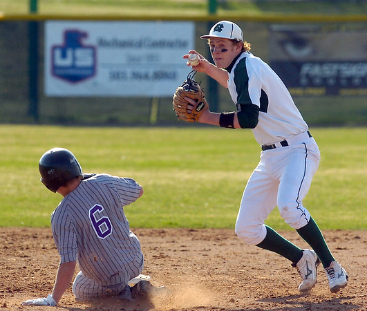 Connor Messinger of Niwot High turns a double play against Luke Baumannduring the Niwot High vs Mountain View game at Niwot High School on Wednesday April 7, 2010.<br /> Photo by Paul Aiken / The Camera