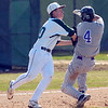 Niwot's #20 Ryan Sypher tags out Joey Hlushak during the Niwot High vs Mountain View game at Niwot High School on Wednesday April 7, 2010.<br /> Photo by Paul Aiken / The Camera