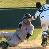 Derek Neeper is tagged out at the plate by catcher  Matt Perry during the Niwot High vs Mountain View game at Niwot High School on Wednesday April 7, 2010.<br /> Photo by Paul Aiken / The Camera