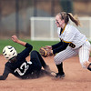 "Niwot High School's Bailey Kleespies slides into second safely under the tag of Kelsey Laughlin during the Colorado State 4A Championship game against Pueblo East High School on Saturday, Oct. 20, at the Aurora Sports Park in Aurora. Niwot lost the game 4-2.  For more photos of the game go to  <a href=""http://www.dailycamera.com"">http://www.dailycamera.com</a><br /> Jeremy Papasso/ Camera"