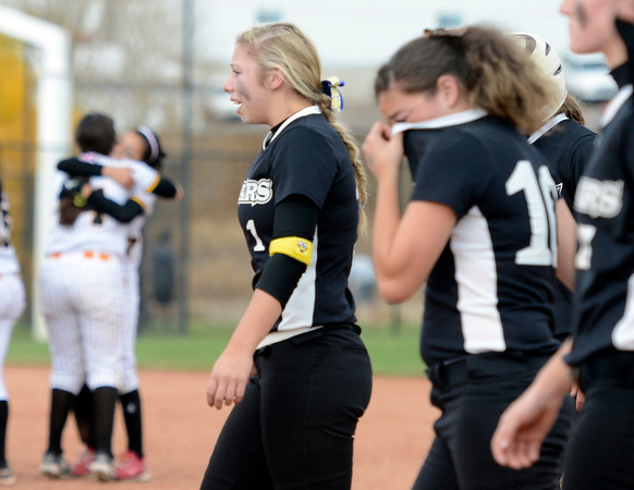 """Niwot High School's Brooklynn DeLozier, right, and Taylor Supino walk off the field as the Pueblo East team celebrates in the background during the Colorado State 4A Championship game against Pueblo East High School on Saturday, Oct. 20, at the Aurora Sports Park in Aurora. Niwot lost the game 4-2.  For more photos of the game go to  <a href=""""http://www.dailycamera.com"""">http://www.dailycamera.com</a><br /> Jeremy Papasso/ Camera"""
