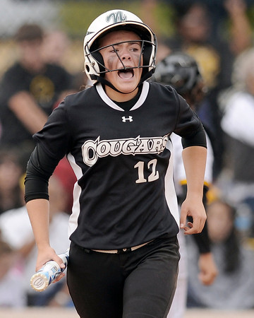 "Niwot High School's Bailey Kleespies tries to keep her team pumped up after batting during the Colorado State 4A Championship game against Pueblo East High School on Saturday, Oct. 20, at the Aurora Sports Park in Aurora. Niwot lost the game 4-2.  For more photos of the game go to  <a href=""http://www.dailycamera.com"">http://www.dailycamera.com</a><br /> Jeremy Papasso/ Camera"