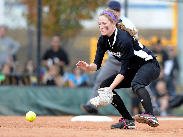 "Niwot High School's Mikalah Artzer stops a ground ball to make an out during the Colorado State 4A Championship game against Pueblo East High School on Saturday, Oct. 20, at the Aurora Sports Park in Aurora. Niwot lost the game 4-2.  For more photos of the game go to  <a href=""http://www.dailycamera.com"">http://www.dailycamera.com</a><br /> Jeremy Papasso/ Camera"