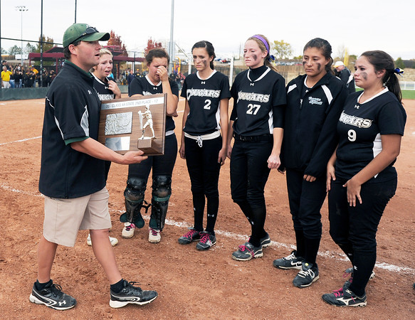 "Niwot High School Head Coach Bobby Matthews presents the Niwot varsity girls with the second place trophy after the Colorado State 4A Championship game against Pueblo East High School on Saturday, Oct. 20, at the Aurora Sports Park in Aurora. Niwot lost the game 4-2.  For more photos of the game go to  <a href=""http://www.dailycamera.com"">http://www.dailycamera.com</a><br /> Jeremy Papasso/ Camera"