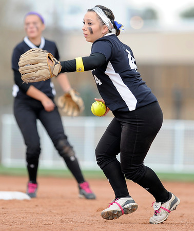 "Niwot High School's Raven Baca picks the ball up to make an out at first base during the Colorado State 4A Championship game against Pueblo East High School on Saturday, Oct. 20, at the Aurora Sports Park in Aurora. Niwot lost the game 4-2.  For more photos of the game go to  <a href=""http://www.dailycamera.com"">http://www.dailycamera.com</a><br /> Jeremy Papasso/ Camera"