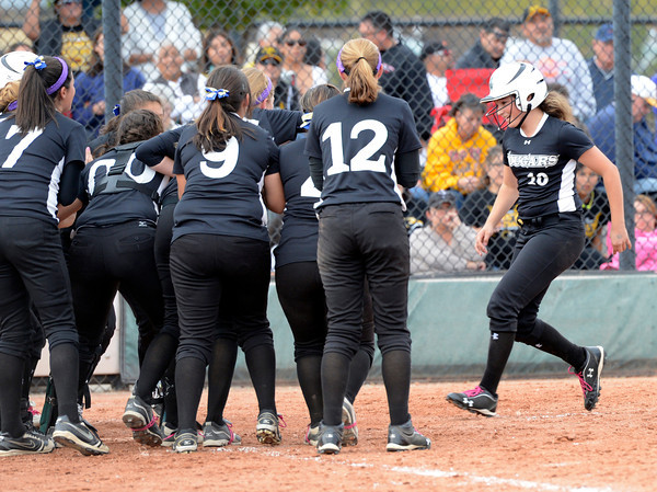 "Niwot High School's Brooklynn DeLozier, right, is congratulated by her team at home plate after hitting a home run during the Colorado State 4A Championship game against Pueblo East High School on Saturday, Oct. 20, at the Aurora Sports Park in Aurora. Niwot lost the game 4-2.  For more photos of the game go to  <a href=""http://www.dailycamera.com"">http://www.dailycamera.com</a><br /> Jeremy Papasso/ Camera"