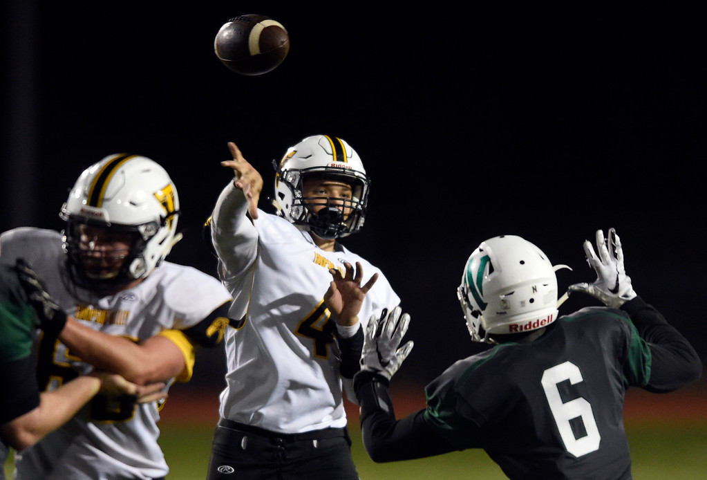 . LONGMONT, CO - OCTOBER 4, 2018: Thompson Valley\'s Cameron Nellor completes a pass during a game against Niwot on Thursday at Longmont High School. More photos: BoCoPreps.com (Photo by Jeremy Papasso/Staff Photographer)
