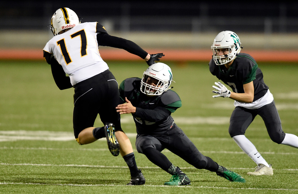 . LONGMONT, CO - OCTOBER 4, 2018: Niwot High School\'s Julian Molina makes a tackle on James Dyken during a game against Thompson Valley on Thursday at Longmont High School. More photos: BoCoPreps.com (Photo by Jeremy Papasso/Staff Photographer)